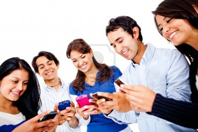 13535673 Group Of Young People Texting On Their Cell Phones Isolated Over White